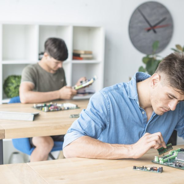 hardware-technician-students-practicing-with-computer-components